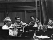 """Sasha would often say """"don't play orchestra, play chamber music."""" This 1960s orchestra rehearsal photo with Shmuel Ashkenasi (Vermeer Quartet), Charles Avsharian, Florika Remetier, Jaime Laredo (Kalichstein-Laredo-Robinson Trio), and Arnold Steinhardt (Guarneri Quartet) shows that they must have taken his admonition to heart. Photo by Judson Hall."""